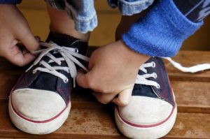 Kids tying shoe laces