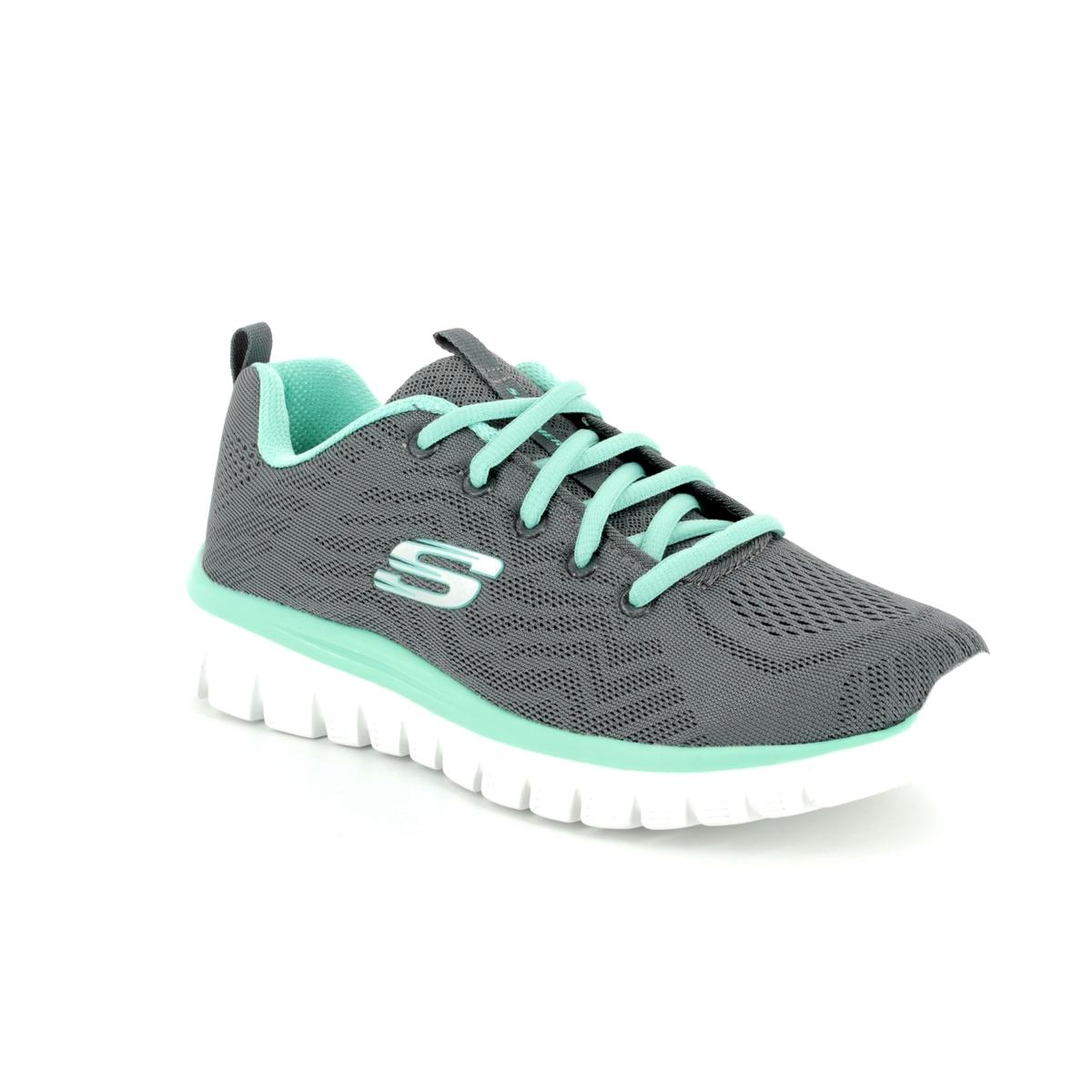 green skechers trainers